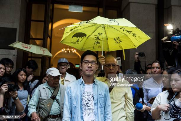 TOPSHOT Prodemocracy activist Nathan Law walks past the media outside the Court of Final Appeal after he and Joshua Wong's bail application were...