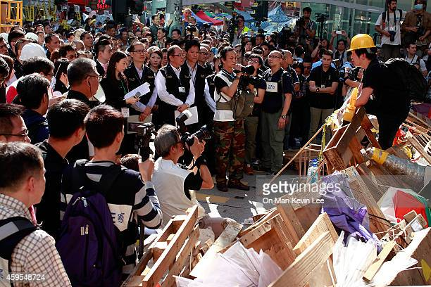 A prodemocracy activist negotiates with bailiff and lawyer before they move to clear barricades set up by prodemocracy activists at Mongkok area on...