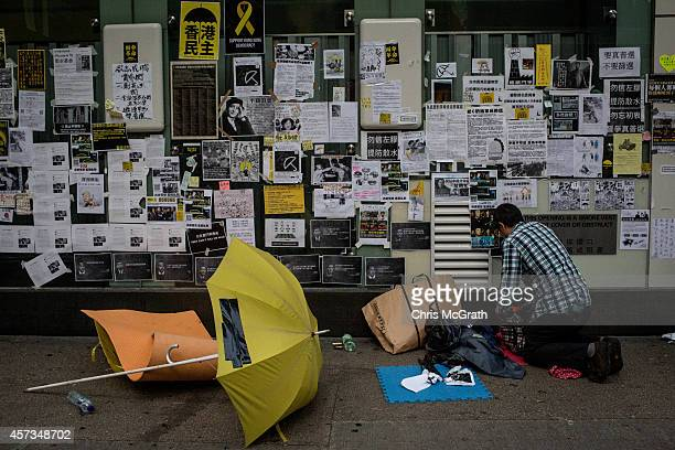 A prodemocracy activist packs up his things after a dawn police raid to clear out the Occupy Central Mong Kok protest site on October 17 2014 in Hong...