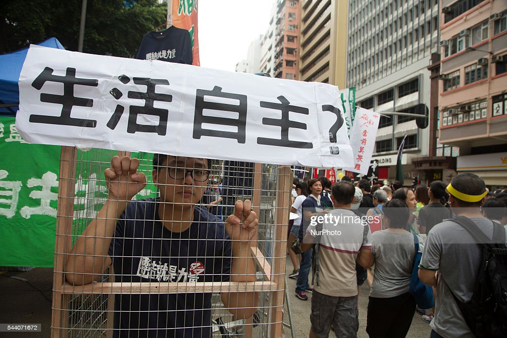Pro-Democracy activist performs during the march in Hong Kong, July 1 2016. Pro Democracy protesters march as the city marks the 19th anniversary of the handover from Uk to China.