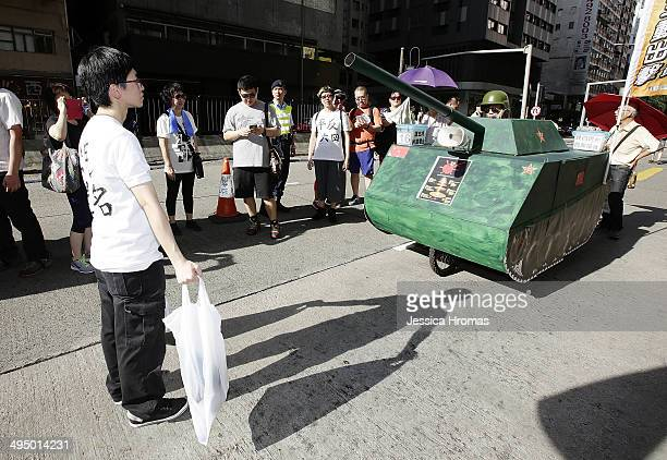 Prodemocracy activist reenacts an iconic moment from the prodemocracy movement protests of 1989 when a young man blocked the path of Chinese tanks...