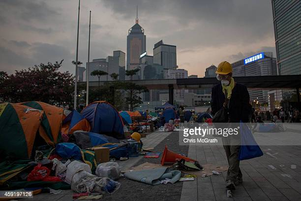 A prodemocracy activist walks through a destroyed section of the protest site outside the Legislative Council building after protesters clashed with...