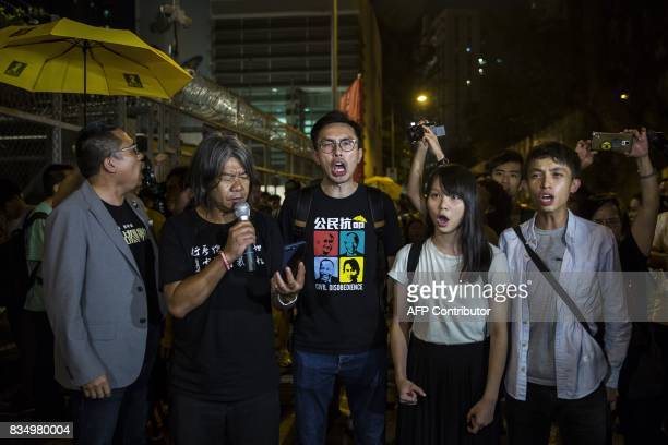 Prodemocracy activists Leung Kwokhung also known as 'Long Hair' Avery Ng Agnes Chow and Figo Chan shout slogans at a rally in front of the Lai Chi...