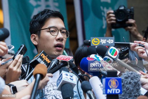 Prodemocracy activists Nathan Law speaks to the media out side the Court of Final Appeal after he and Joshua Wong's bail application were successful...