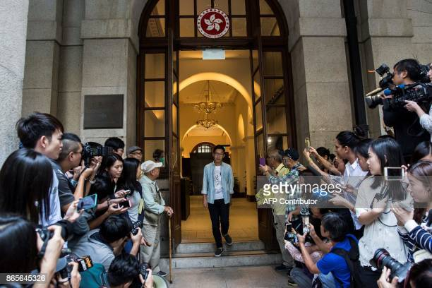 Prodemocracy activists Nathan Law walks out of the Court of Final Appeal after he and Joshua Wong's bail application were successful at Hong Kong's...