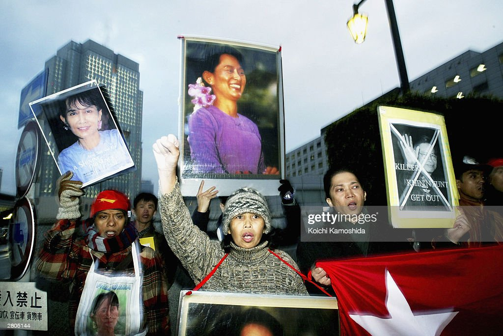 Pro-democracy citizens from Myanmar living in Japan, some holding placards of their leader Aung San Suu Kyi, demostrate against Myanmar Prime Minister General Khin Nyunt December 12, 2003 in Tokyo, Japan. Nyunt is in Japan to attended the two-day Japan-ASEAN Commemorative Summit to discuss economic and security relations.