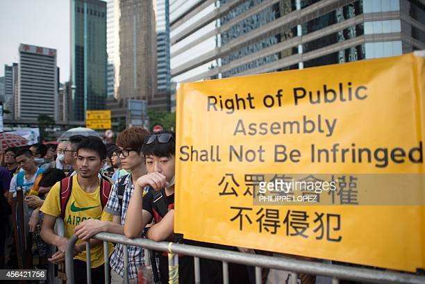 Prodemocracy demonstrators gather near a ceremony marking China's 65th National Day in Hong Kong on October 1 2014 Hong Kong protesters who braved...