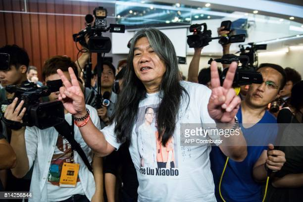 Prodemocracy lawmaker Leung Kwokhung also known as 'long hair' gestures as he leaves the legislature Council meeting in Hong Kong on July 14 after a...