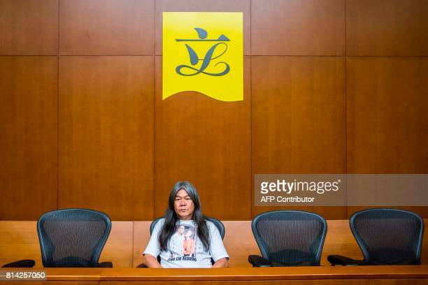 TOPSHOT Prodemocracy lawmaker Leung Kwokhung also known as 'long hair' sits alone at a press conference in Hong Kong on July 14 after a verdict was...