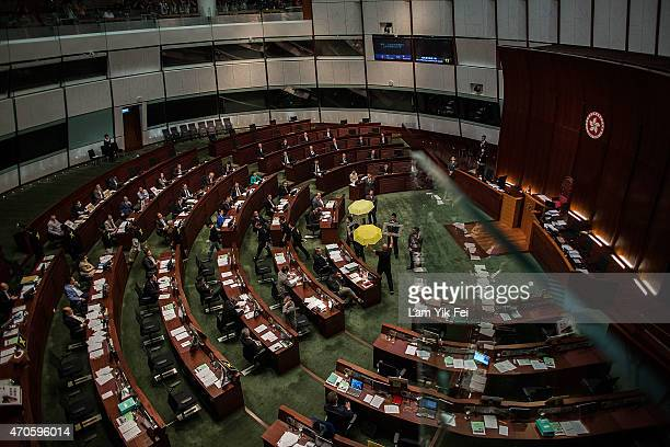 Prodemocracy lawmakers leave to boycott Hong Kong Chief Secretary Carrie Lam during a Legislative Council meeting on April 22 2015 in Hong Kong Hong...