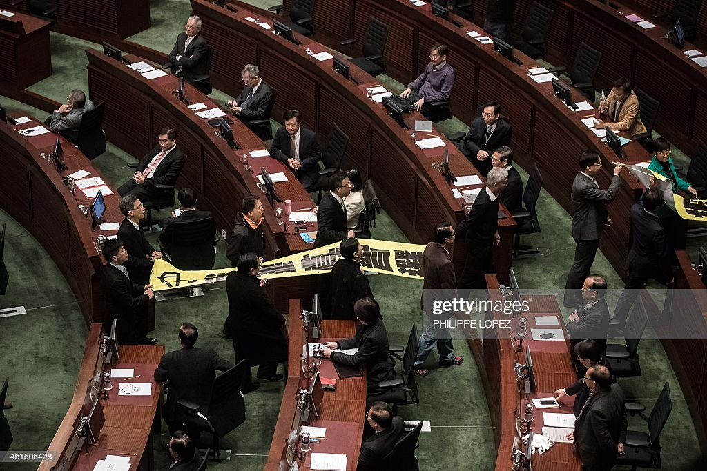 Prodemocracy lawmakers walk out in protest before the policy address of Hong Kong Chief Executive Leung Chunying in the legislative council in Hong...