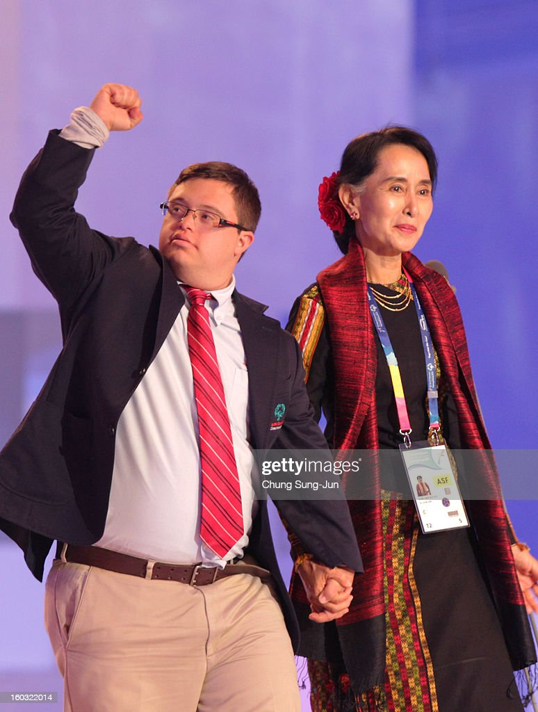 Pro-democracy leader Aung San Suu Kyi (R) and Special Olympics global messenger Ariel Ary of Costa Rica attend the Opening Ceremony of the 2013 Pyeongchang Special Olympics World Winter Games at the Yongpyeong stadium on January 29, 2013 in Pyeongchang-gun, South Korea.