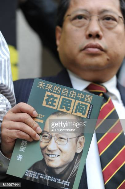 Prodemocracy legislator Albert Ho attends a press conference asking for the release of mainland jailed dissident Liu Xiaobo outside the legislative...