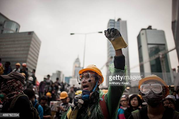 Prodemocracy protester raises his hand and shouts slogan outside Central Government Complex on December 1 2014 in Hong Kong Leaders from the...