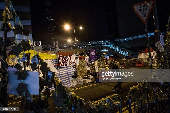 A prodemocracy protester walks past a first aid tent in the early hours of Monday morning outside the Hong Kong Government complex on October 6 2014...