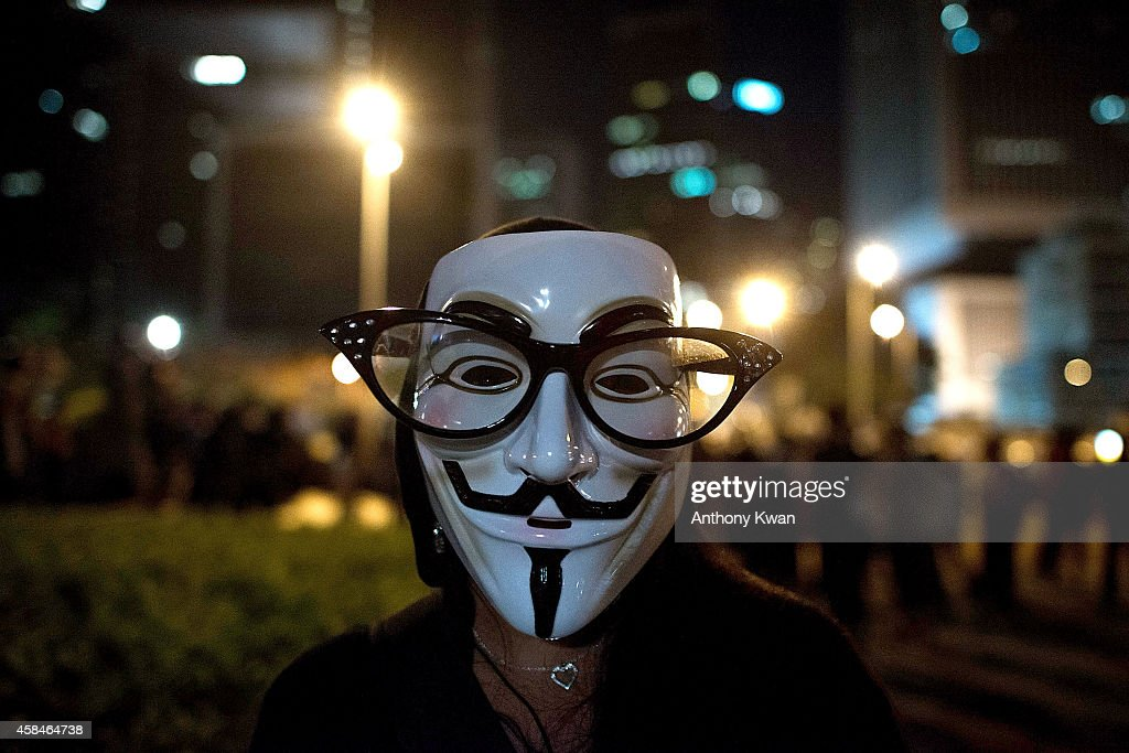 A pro-democracy protester wears a Guy Fawkes mask on a street near Hong Kong Government Complex in Admiralty district on November 5, 2014 in Hong Kong. Pro-democracy protesters staged a rally on Guy Fawkes day.