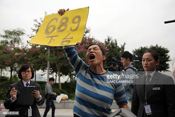 A prodemocracy protester yells as she is led from the Legislative Council building in the Admiralty district of Hong Kong on December 15 2014 Police...