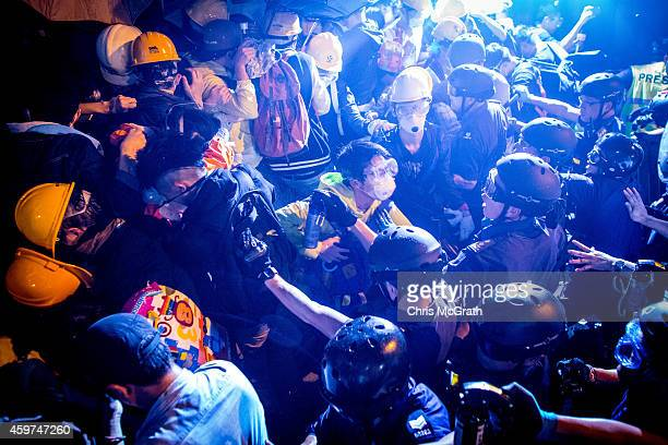 Prodemocracy protesters clash with police as they try to take over Lung Wo Road outside Hong Kong's Government complex on November 30 2014 in Hong...