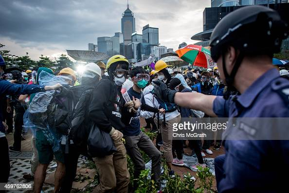 Prodemocracy protesters clash with police outside Hong Kong's Government complex on December 1 2014 in Hong Kong Leaders from the Federation of...