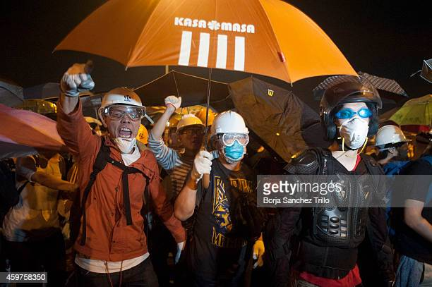 Prodemocracy protesters clash with the Hong Kong police on Lung Wo Road on November 30 2014 in Hong Kong Leaders from the Federation of Students...