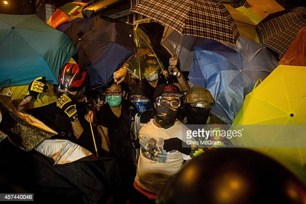 Prodemocracy protesters face off with advancing police on a street in Mong Kok on October 19 2014 in Hong Kong Hong Kong Police have begun to take...