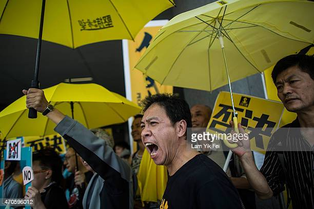 Prodemocracy protesters hold yellow umbrellas a symbol of the prodemocracy protests during a demonstration outside Legislative Council in Hong Kong...
