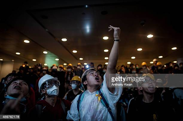 Prodemocracy protesters make gustures to the police on an escalator outside Central Government Complex on December 1 2014 in Hong Kong Leaders from...
