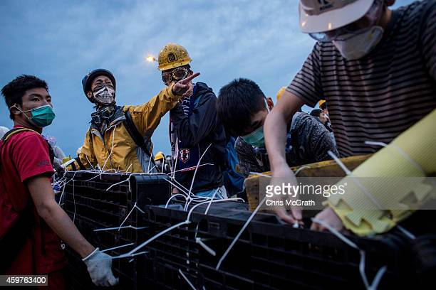 Prodemocracy protesters prepare a barricade ahead of clashes with police on Lung Wo road outside Hong Kong's Government complex on December 1 2014 in...