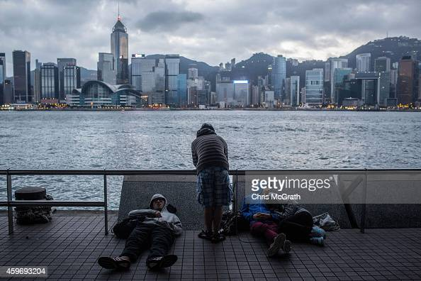 Prodemocracy protesters relax as the sun rises after marching from Mong kok district towards Tsim Sha Tsu in the early hours of the morning on...