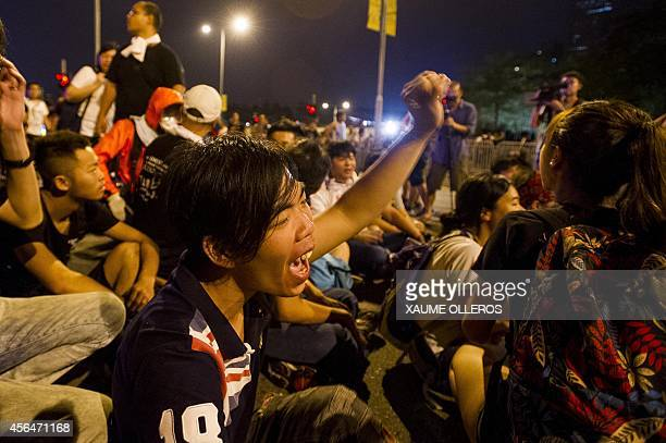 Prodemocracy protesters sit as they wait for Hong Kong chief executive outside the Legislative Counsel Office on October 2 2014 in Hong Kong Hong...