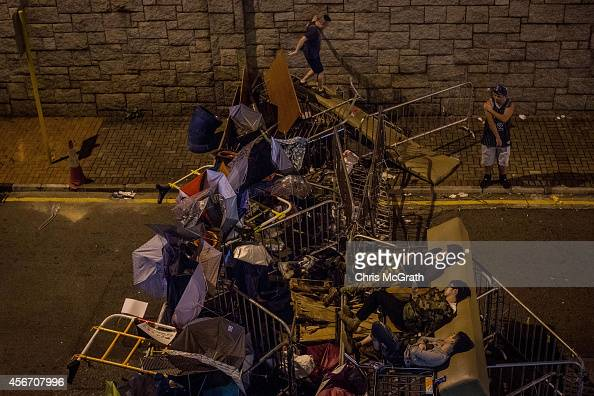 Prodemocracy protesters sleep while guarding a road barricade in the early hours of Monday morning outside the Hong Kong Government complex on...