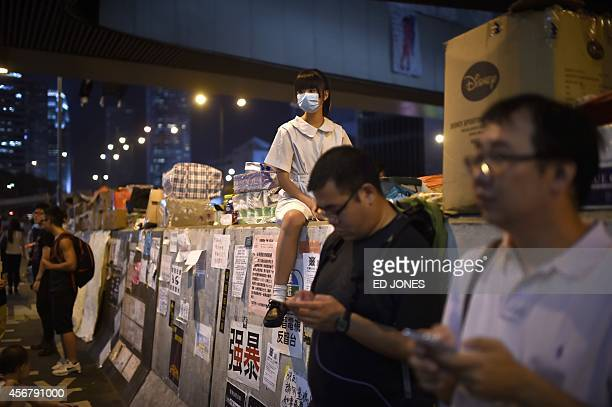 Prodemocracy protesters wait for the arrival of Letitia Lee Seeyin leader of the antioccupy 'Blue Ribbon' group in the Admiralty district of Hong...