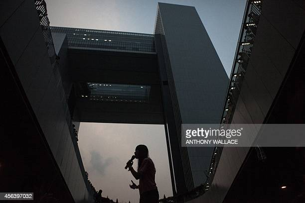 A prodemocracy protestor speaks to the crowd in front of the government offices in Hong Kong on September 30 2014 Hong Kong has been plunged into the...
