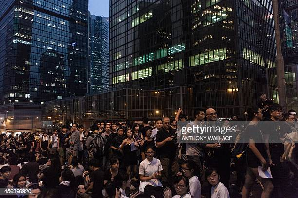 Prodemocracy protestors gather on a major road in front of office buildings in Hong Kong on September 30 2014 Hong Kong has been plunged into the...