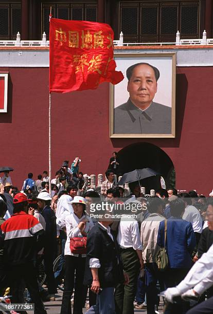 Prodemocracy supporters mill around under a protest flag erected in front of the portrait of Mao Tse Tung at the entrance to the Forbidden City in...