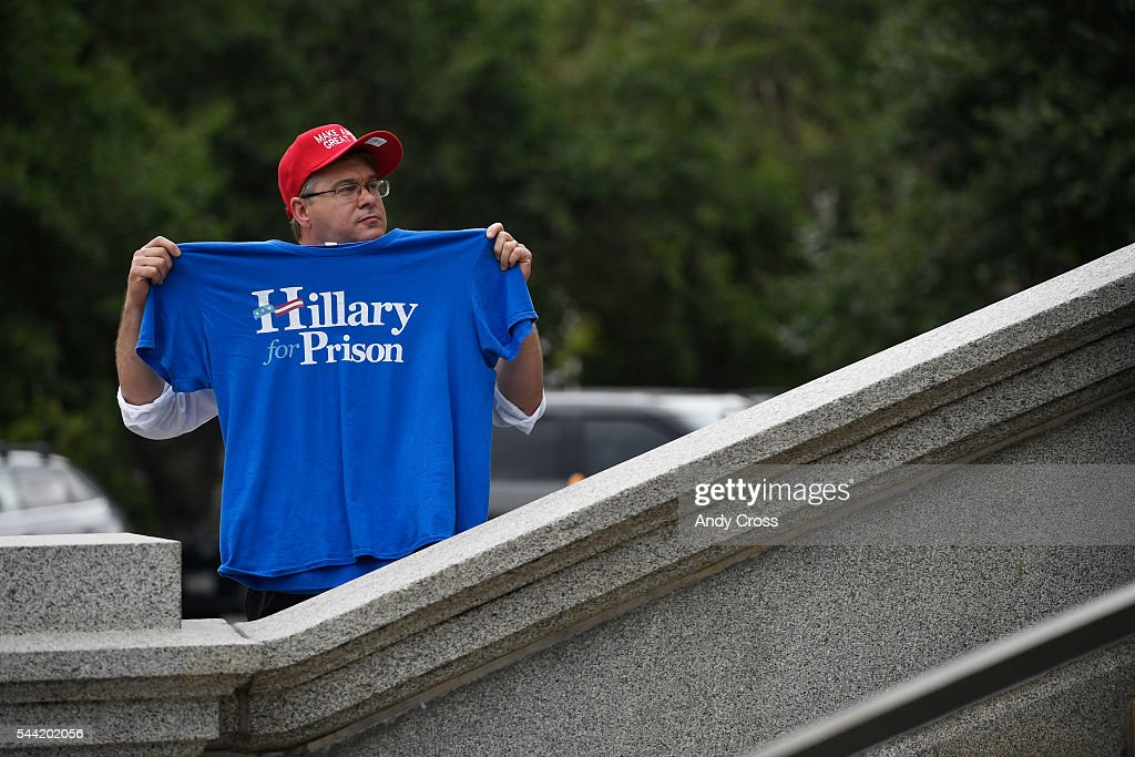 Pro-Donald Trump supporter Mark Auville shows his support at a rally on the west steps of the Colorado State Capitol July 01, 2016. The GOP Presidential Candidate was in town for the Western Conservative Summit.
