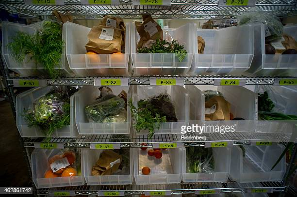 Produce and fruit organized in bins stand on a cart at the Good Eggs distribution center in San Francisco California US on Thursday Feb 5 2015 Good...