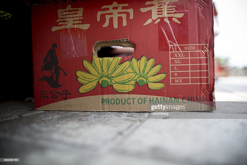 A produce box sits at a fruit stall in the Dadonghai district of Sanya, Hainan Province, China, on Monday, April 7, 2014. The yuan is poised to recover from declines that have made it Asia's worst-performing currency as China seeks to prevent an exodus of capital that would threaten economic growth, according to the most accurate forecasters. Photographer: Brent Lewin/Bloomberg via Getty Images