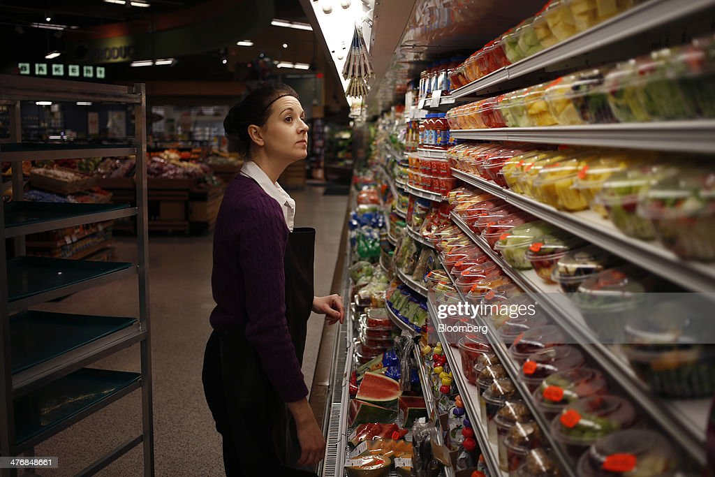 Produce clerk Lucy Shuford inspects shelves in the produce aisle after stocking them with fruit at a Publix Super Markets Inc. grocery store in Knoxville, Tennessee, U.S., on Wednesday, March 5, 2014. Publix's sales for the fourth quarter of 2013, were $7.4billion, a 5.3 percent increase from last year's $7.0 billion. Photographer: Luke Sharrett/Bloomberg via Getty Images