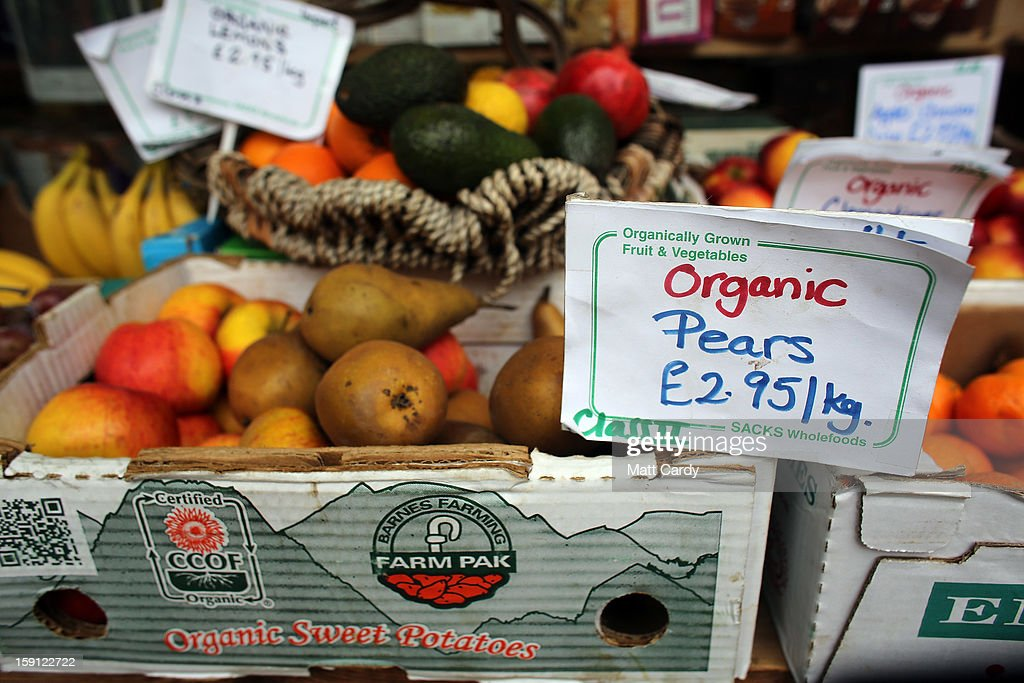 Produce is seen displayed outside a shop on the main shopping street of Totnes on January 8, 2013 in Totnes, England. The Devon town is renowned for its belief in promoting trade of local independent retailers, famously denying the plans by national coffee chain Costa to open a high street branch in the town. Boasting its own local currency, Totnes has a shop vacancy rate of 6%, less than half than the national average, whilst 80% of outlets are independently owned.