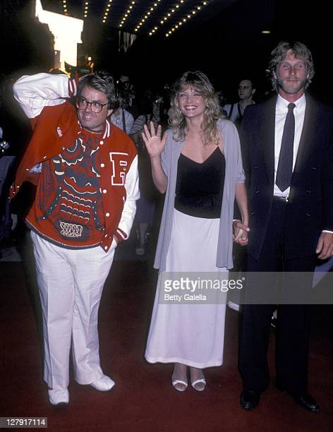 Producer Allan Carr actress Michelle Pfeiffer and actor Peter Horton attend the 'Grease 2' New York City Premiere on June 9 1982 at the Ziegfeld...