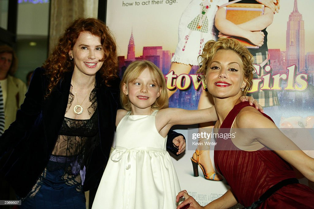 Producer Allison Jacobs, actress Dakota Fanning and actress Brittany Murphy attend the MGM Pictures Los Angeles premiere of the film 'Uptown Girls' at the ArcLight Cinerama Dome August 4, 2003 in Hollywood, California.