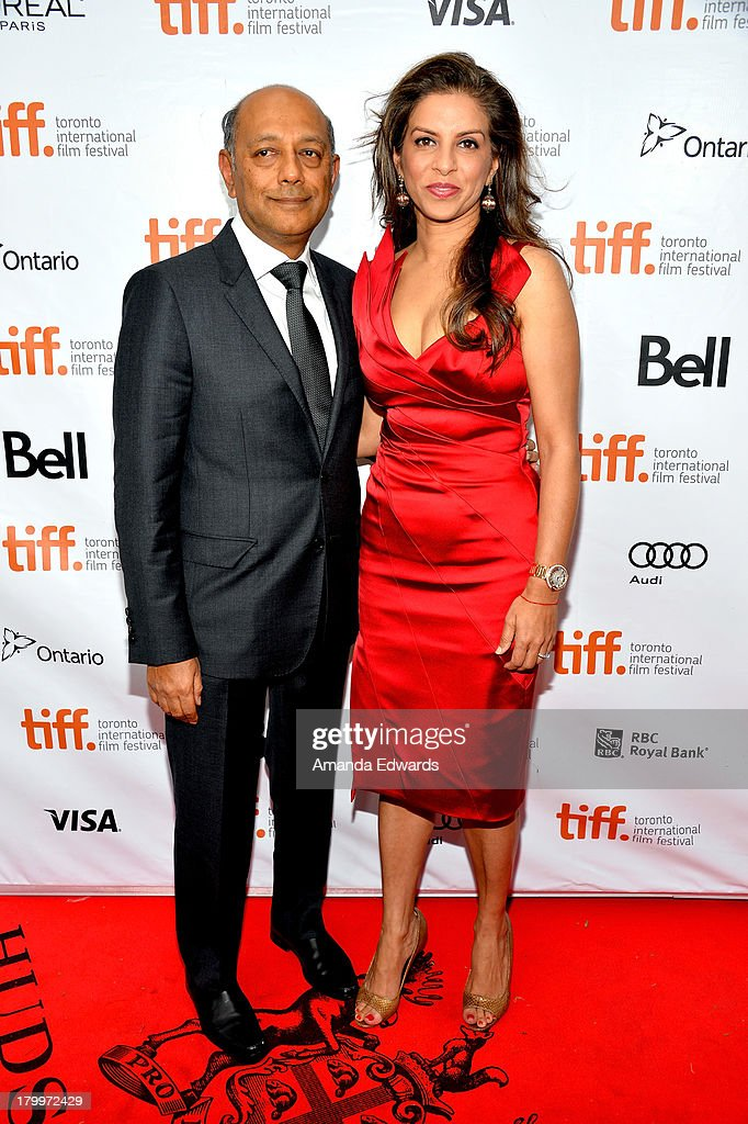 Producer Anant Singh (L) and Vanashree Singh attend the 'Mandela: Long Walk To Freedom' premiere during the 2013 Toronto International Film Festival at Roy Thomson Hall on September 7, 2013 in Toronto, Canada.
