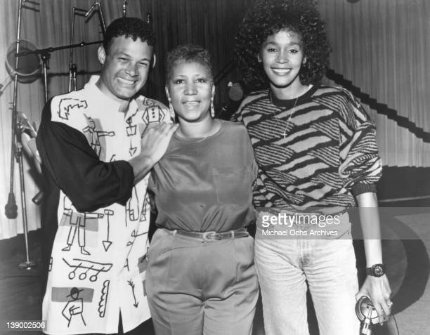 Producer and arranger Narrada Michael Walden Aretha Franklin and Whitney Houston pose for a portrait during the recording of the song 'It Isn't It...