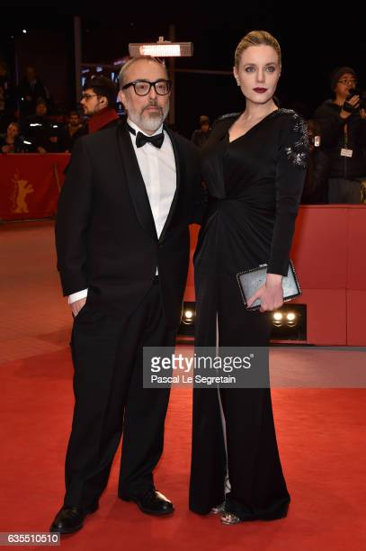 Producer and director Alex de la Iglesia and producer Carolina Bang attend the 'The Bar' premiere during the 67th Berlinale International Film...