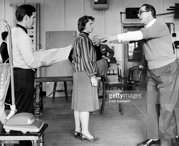 Producer and director John Blatchley rehearses soprano April Cantelo and tenor Raymond Nilsson for a scene in the opera 'Our Man in Havana' by...