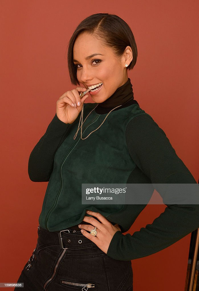 Producer and musician <a gi-track='captionPersonalityLinkClicked' href=/galleries/search?phrase=Alicia+Keys&family=editorial&specificpeople=169877 ng-click='$event.stopPropagation()'>Alicia Keys</a> poses for a portrait during the 2013 Sundance Film Festival at the Getty Images Portrait Studio at Village at the Lift on January 18, 2013 in Park City, Utah.