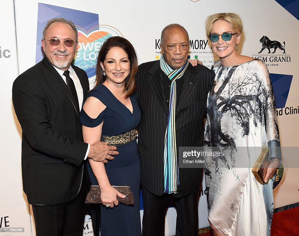 Producer and musician Emilio Estefan Jr., singer Gloria Estefan, record producer Quincy Jones and actress Sharon Stone attend the 19th annual Keep Memory Alive 'Power of Love Gala' benefit for the Cleveland Clinic Lou Ruvo Center for Brain Health honoring Andrea Bocelli and Veronica Bocelli at MGM Grand Garden Arena on June 13, 2015 in Las Vegas, Nevada.