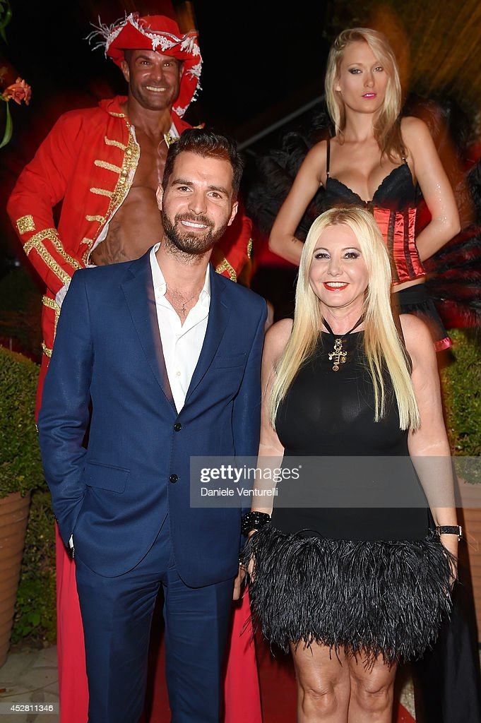 Producer Andrea Iervolino and Lady Monika Bacardi Of AMBI Pictures attends Monika Bacardi Summer Party 2014 St Tropez at Les Moulins de Ramatuelle on July 27, 2014 in Saint-Tropez, France.