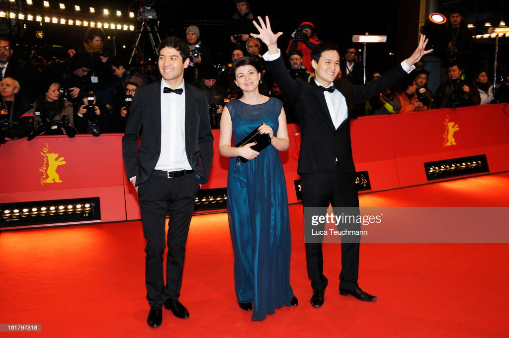 Producer Anna Katchko (C) and director Emir Baigazin (1st R) attend the Closing Ceremony of the 63rd Berlinale International Film Festival at Berlinale Palast on February 14, 2013 in Berlin, Germany.